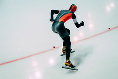 Men athlete to sprint speed skating. Speed skating  indoors Stock Photo