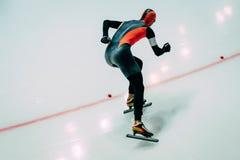 Men athlete to sprint speed skating Stock Photo