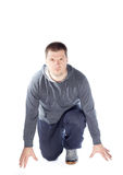 Men athlete. Young man athlete preparing to run isolated on white background, wearing jogging outfit Stock Photography