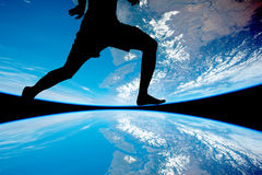 The Men athletes running. Silhouette of the Men athletes running , the backdrop of the planet earth. Elements of this image furnished by NASA royalty free stock photo