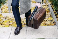 Men autumn fashion. Man in stylish shoes and a white coat Stock Images