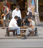 Men backgammon on pavement of Istanbul Stock Image