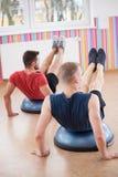 Men during balance training Stock Photo