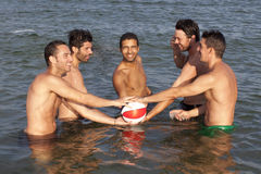 Men with ball in water Royalty Free Stock Images