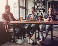 Men in bar stock images
