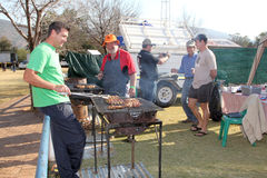Men barbequing kebabs at Festival Royalty Free Stock Photography