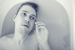 Men in the bath Stock Photo