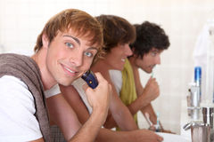 3 men in bathroom Stock Photo