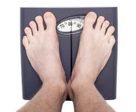 Men on bathroom scale Royalty Free Stock Photos