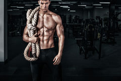 Men with battle rope battle ropes exercise in the fitness gym. CrossFit. royalty free stock image