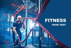 Men with battle rope battle ropes exercise in the fitness gym. CrossFit concept. gym, sport, rope, training, athlete, workout, exercises concept royalty free stock image