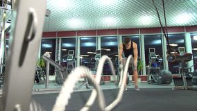 Men with battle rope in functional training fitness gym. young cute model. stock footage