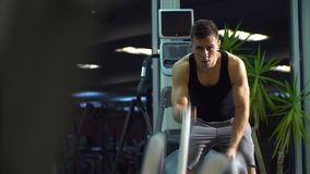 Men with battle rope in functional training fitness gym. young cute model. stock video footage
