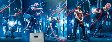 Men with battle rope battle ropes exercise in the fitness gym. stock image