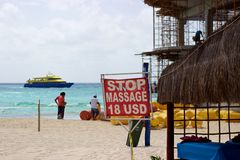 Men on beach, ferry from Cozumel, Playa del Carmen, Mexico Stock Photography