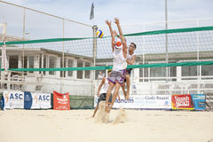 Men beach volleyball players. Italian national championship. 29 June 2015. Location: Ostia (near Rome), Italy. Attack and defense Stock Images