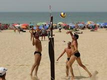 Men beach volleyball. Sportsmen playing beach volleyball. Volley ball competition on the beach Stock Photos
