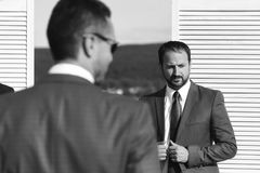 Men with beard and concerned faces discuss business. Executives make deal. Business, work and cooperation concept. Stock Image