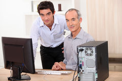 Men behind a computer Stock Photo