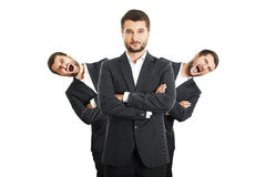 Men behind confident young businessman Stock Photo