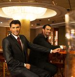 Men  behind gambling table Royalty Free Stock Photos