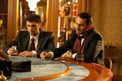 Men behind gambling table Royalty Free Stock Photography