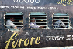 Men behind the window. People in the train. Kerala, India, South Asia Royalty Free Stock Photos