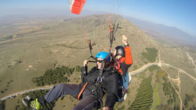 Men being afraid while paragliding Royalty Free Stock Photography