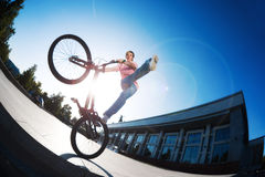 Men on the bicycle doing stunt. Bike trial teenager boy urban background Stock Photo
