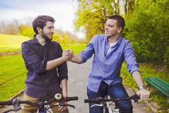 Men with bicycles Royalty Free Stock Photos