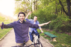 Men with bicycles Stock Images