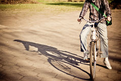 Men on bike dropping shadow. Picture presents men on bike dropping shadow Stock Image