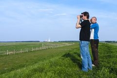 Men with binoculars royalty free stock images