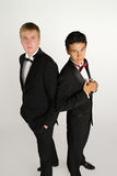 Men in black back to back. Two young artists in tuxedos Stock Photography