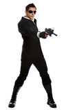 Men in black suit holding gun Stock Photography