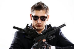 Men in black suit holding gun Stock Images