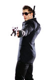 Men in black suit holding gun Royalty Free Stock Photo