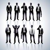 Men in black suits Stock Images