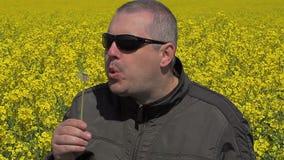 Men blowing dandelion. In summer day stock video
