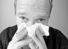 Men blowing his nose. Influenza ...allergy royalty free stock photo