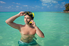 Men in blue ocean wearing yellow diving mask Royalty Free Stock Photography
