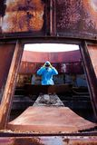Man environment mask dark facemask icon protective overall blue orange rast factory disused catastrophe chernobyl. Men in blue protective overall on lost soviet royalty free stock image
