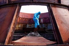Man environment mask dark facemask icon protective overall blue orange rast factory disused catastrophe chernobyl. Men in blue protective overall on lost soviet stock image