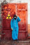 Man environment mask face radiation facemask icon protective overall blue orange rast factory disused catastrophe. Men in blue protective overall near icon of stock photo