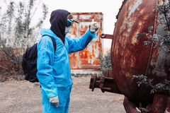 Man environment mask drum pack disguise facemask water muddy protective overall blue rast plant factory disused catastrophe. Men in blue protective overall at royalty free stock images