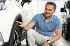 Men touching car wheel royalty free stock image