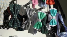 Men bow ties in a store. Men bow ties in a fashion clothes store stock video footage