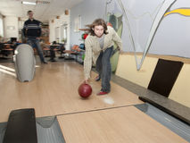 Men by bowling. In the bar - fling Royalty Free Stock Photography