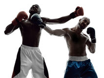 Men boxers boxing isolated silhouette. Two men boxers boxing on isolated silhouette white background Stock Photo
