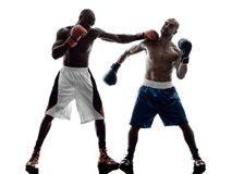 Men boxers boxing isolated silhouette. Two men boxers boxing on isolated silhouette white background Stock Images